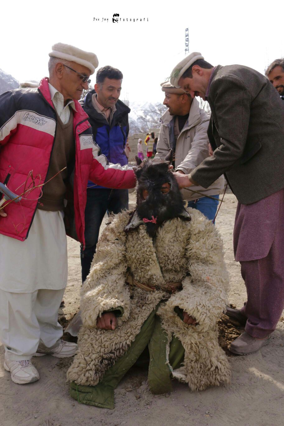A man dressed to appear as an Oxen is being prepared for the show. Photo: Deedar Ali
