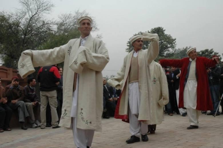 Elders dance wearing Shuqa