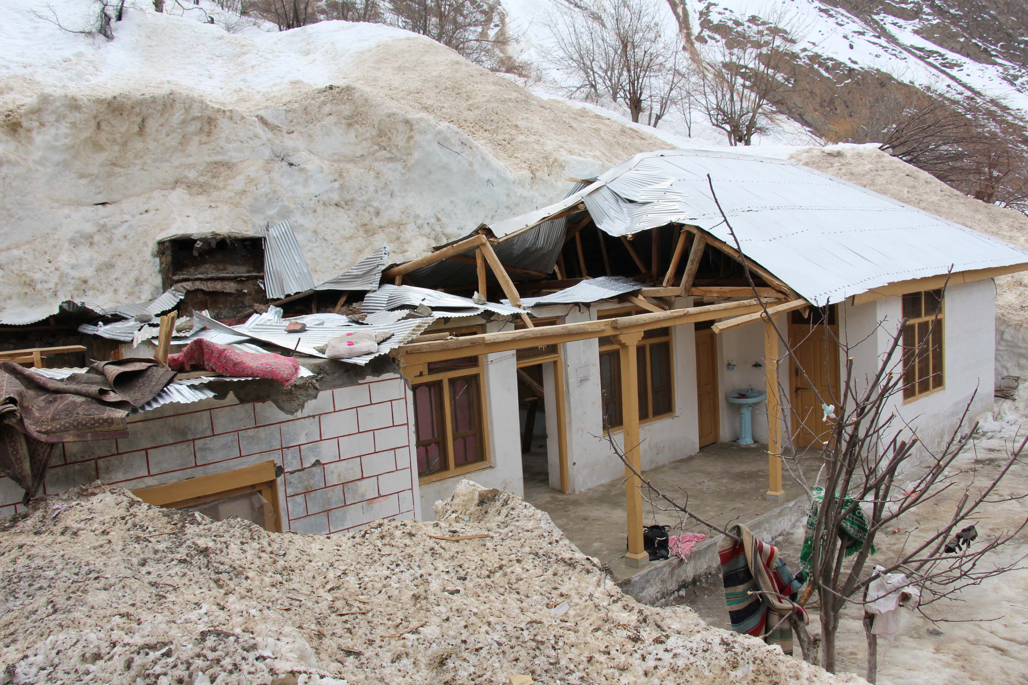 100 years old man waits for help after house is destroyed by snow avalanche